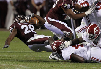 STARKVILLE, MS - NOVEMBER 12:  Linebacker Courtney Upshaw #41 of the Alabama Crimson Tide tackles running back Vick Ballard #28 of the Mississippi State Bulldogs for a loss on November 12, 2011 at Davis Wade Stadium in Starkville, Mississippi. Alabama won