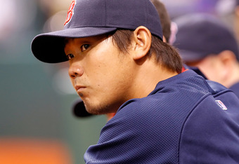 ST. PETERSBURG, FL - SEPTEMBER 09:  Pitcher Daisuke Matsuzaka #18 of the Boston Red Sox watches his team against the Tampa Bay Rays during the game at Tropicana Field on September 9, 2011 in St. Petersburg, Florida.  (Photo by J. Meric/Getty Images)