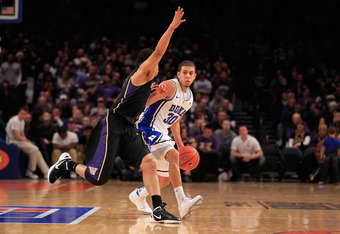 NEW YORK, NY - DECEMBER 10: Seth Curry #30 of the Duke Blue Devils is challenged by Abdul Gaddy #0 of the Washington Huskies  at Madison Square Garden on December 10, 2011 in New York City.  (Photo by Chris Trotman/Getty Images)