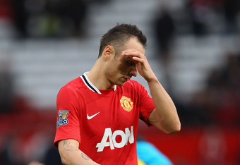 MANCHESTER, ENGLAND - DECEMBER 31: Dimitar Berbatov of Manchester United off dejected after losing 3-2  in the Barclays Premier League match between Manchester United and Blackburn Rovers at Old Trafford on December 31, 2011 in Manchester, England.  (Phot