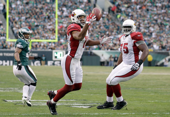 PHILADELPHIA, PA - NOVEMBER 13:  Larry Fitzgerald #11 of the Arizona Cardinals catches a tipped pass for a second half touchdown against the Philadelphia Eagles at Lincoln Financial Field on November 13, 2011 in Philadelphia, Pennsylvania.  The Cardinals