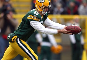 GREEN BAY, WI - NOVEMBER 30:  Punter Derrick Frost #6 of the Green Bay Packers punts the ball against the Carolina Panthers at Lambeau Field on November 30, 2008 in Green Bay, Wisconsin. The Panthers won 35-31.  (Photo by Jonathan Daniel/Getty Images)