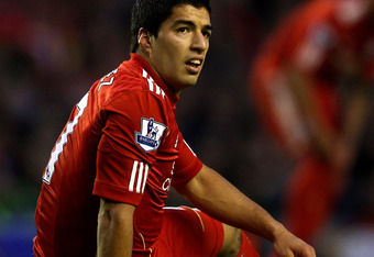 LIVERPOOL, ENGLAND - OCTOBER 22:   Luis Suarez of Liverpool reacts to a missed chance during the Barclays Premier League match between Liverpool and Norwich City at Anfield on October 22, 2011 in Liverpool, England. (Photo by Richard Heathcote/Getty Image