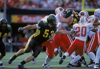 1 Sep 2001:  Igor Olshansky #53 of the Oregon Ducks running after the ball during the game against the Wisconsin Badgers at Autzen Stadium in Eugene, Oregon. The Ducks defeated the Badgers 31-28.Mandatory Credit: Otto Greule  /Allsport