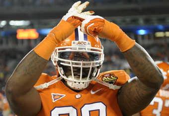CHARLOTTE, NC - DECEMBER 03:  Defensive tackle DeShawn Williams of the Clemson Tigers celebrates after defeating the Virginia Tech Hokies in the ACC Championship game at Bank of America Stadium on December 3, 2011 in Charlotte, North Carolina.  (Photo by