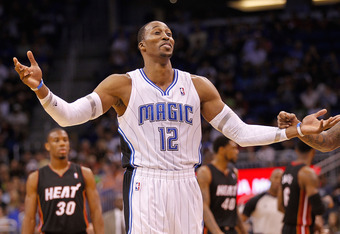ORLANDO, FL - DECEMBER 21: Dwight Howard #12 of the Orlando Magic argues a call during a preseason game against the Miami Heat at Amway Center on December 21, 2011 in Orlando, Florida. NOTE TO USER: User expressly acknowledges and agrees that, by download