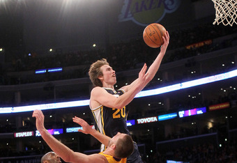 LOS ANGELES, CA - DECEMBER 27:  Gordon Hayward #20 of the Utah Jazz scores a basket and draws a foul against Josh McRoberts #6 of the Los Angeles Lakers at Staples Center on December 27, 2011 in Los Angeles, California.  NOTE TO USER: User expressly ackno