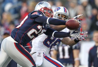 FOXBORO, MA - JANUARY 1:   Sterling Moore #29 of the New England Patriots intercepts a pass intended for  David Nelson #86 of the Buffalo Bills in the second half at Gillette Stadium on January 1, 2012 in Foxboro, Massachusetts. (Photo by Jim Rogash/Getty