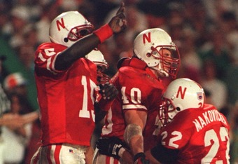 1 JAN 1995:  TOMMIE FRAZIER, #15, CELEBRATES THE SECOND TOUCHDOWN OF CORY SCHLEZINGER, #40, DURING THE CORNHUSKERS ORANGE BOWL WIN OVER THE UNIVERSITY OF MIAMI HURRICANES AT JOE ROBBIE STADIUM IN MIAMI, FLORIDA.   Mandatory Credit: Simon Bruty/ALLSPORT