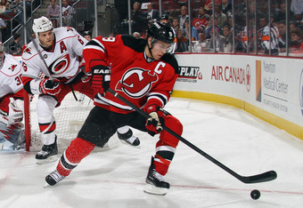 NEWARK, NJ - NOVEMBER 08: Zach Parise #9 of the New Jersey Devils skates against the Carolina Hurricanes at the Prudential Center on November 8, 2011 in Newark, New Jersey. The Devils defeated the Hurricanes 3-2.  (Photo by Bruce Bennett/Getty Images)