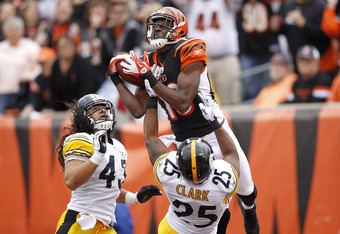 CINCINNATI, OH - NOVEMBER 13: A.J. Green #18 of the Cincinnati Bengals makes a 36-yard touchdown reception in the first quarter over Ryan Clark #25 and Troy Polamalu #43 of the Pittsburgh Steelers at Paul Brown Stadium on November 13, 2011 in Cincinnati,
