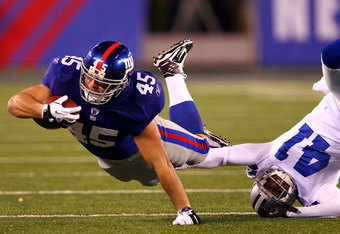 EAST RUTHERFORD, NJ - JANUARY 01:  Henry Hynoski #45 of the New York Giants lunges for extra yardage against Terence Newman #41 of the Dallas Cowboys at MetLife Stadium on January 1, 2012 in East Rutherford, New Jersey.  (Photo by Al Bello/Getty Images)