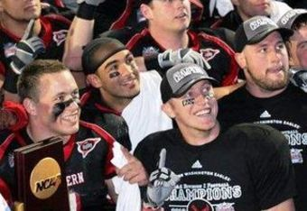 Bo Levi Mitchell and his teammates pose with the National Title trophy