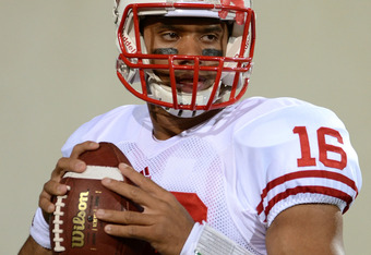 EAST LANSING, MI - OCTOBER 22:  Russell Wilson #16 of the Wisconsin Badgers looks on during pre-game warm ups before the game against the Michigan State Spartans at Spartan Stadium on October 22, 2011 in East Lansing, Michigan.  (Photo by Mark Cunningham/