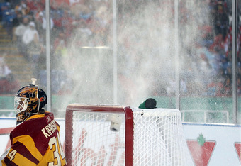 CALGARY, AB - FEBRUARY 20: Miikka Kiprusoff #34 of the Calgary Flames tends net as he is sprayed with ice against the Montreal Canadiens during the 2011 NHL Heritage Classic Game at McMahon Stadium on February 20, 2011 in Calgary, Alberta, Canada.  (Photo
