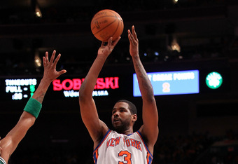 Shawne Williams rising up for a three point attempt last season