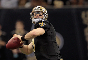NEW ORLEANS, LA - JANUARY 01:  Drew Brees #9 of the New Orleans Saints looks to throw a pass during the game against the Carolina Panthers at the Mercedes-Benz Superdome on January 1, 2012 in New Orleans, Louisiana.  (Photo by Chris Graythen/Getty Images)
