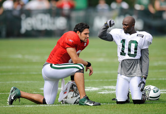 FLORHAM PARK, NJ - AUGUST 07:  Santonio Holmes #10 of the New York Jets talks with Mark Sanchez #6 during the afternoon practice at NY Jets Practice Facility on August 7, 2011 in Florham Park, New Jersey.  (Photo by Patrick McDermott/Getty Images)