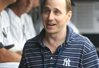 NEW YORK - JULY 2:  General Manager Brian Cashman of the New York Yankees walks through the dugout before the game against the Seattle Mariners at Yankee Stadium on July 2, 2009 in the Bronx borough of New York City.  (Photo by Nick Laham/Getty Images)