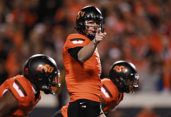 STILLWATER, OK - DECEMBER 03:  Brandon Weeden #3 of the Oklahoma State Cowboys runs the offense during play against the Oklahoma Sooners at Boone Pickens Stadium on December 3, 2011 in Stillwater, Oklahoma.  (Photo by Ronald Martinez/Getty Images)
