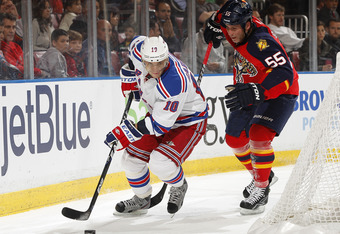 SUNRISE, FL - DECEMBER 30: Marian Gaborik #10 of the New York Rangers skates behind the net while being defended by Ed Jovanovski #55 of the Florida Panthers on December 30, 2011 at the BankAtlantic Center in Sunrise, Florida. (Photo by Joel Auerbach/Gett