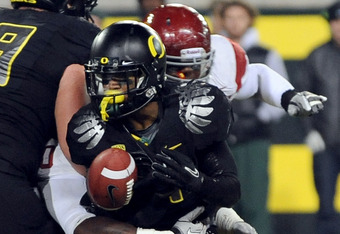 EUGENE, OR - NOVEMBER 19:  Running back LaMichael James #21 of the Oregon Ducks fumbles the ball in the second quarter of the game against the USC Trojans at Autzen Stadium on November 19, 2011 in Eugene, Oregon. USC won the game 38-35. (Photo by Steve Dy