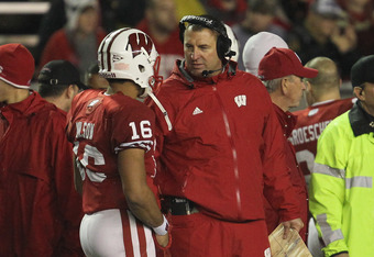 MADISON, WI - NOVEMBER 26: Head coach Bret Bielema of the Wisconsin Badgers talks with Russell Wilson #16 during a game against the Penn State Nittany Lions at Camp Randall Stadium on November 26, 2011 in Madison, Wisconsin. Wisconsin defeated Penn State