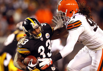 CLEVELAND, OH - JANUARY 01:  Running back Isaac Redman #33 of the Pittsburgh Steelers is hit by defensive lineman Jabaal Sheard #97 of the Cleveland Browns at Cleveland Browns Stadium on January 1, 2012 in Cleveland, Ohio.  (Photo by Matt Sullivan/Getty I