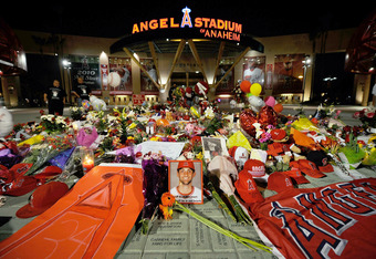 After the loss of Adenhart, Angels fans flocked to the stadium, erecting a makeshift memorial atop a painted pitcher's mound outside the ballpark's main gates. By the postseason, the memorial had spread outward towards home plate, and all three painted bases.