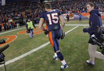 DENVER, CO - JANUARY 01:  Quarterback Tim Tebow #15 of the Denver Broncos leaves the field after being defeated 7-2 by the Kansas City Chiefs at Sports Authority Field at Mile High on January 1, 2012 in Denver, Colorado.  (Photo by Doug Pensinger/Getty Im