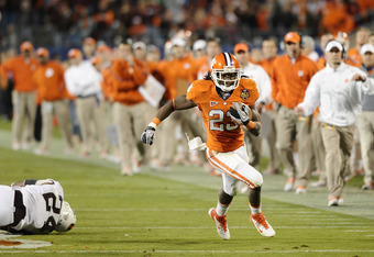 CHARLOTTE, NC - DECEMBER 03:  Running back Andre Ellington #23 of the Clemson Tigers runs down field against the Virginia Tech Hokies during the ACC Championship at Bank of America Stadium on December 3, 2011 in Charlotte, North Carolina.  (Photo by Jared