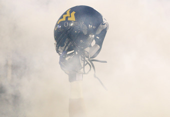 MORGANTOWN, WV - NOVEMBER 25: A member of the West Virginia Mountaineers holds up his helmet before the take the field against the University of Pittsburgh Panthers during the 2011 Backyard Brawl on November 25, 2011 at Mountaineer Field in Morgantown, We