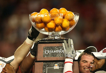 MIAMI, FL - JANUARY 03: Players from the Stanford Cardinal hold up the Orange Bowl Champion trophy after they won 40-12 against the Virginia Tech Hokies during the 2011 Discover Orange Bowl at Sun Life Stadium on January 3, 2011 in Miami, Florida. (Photo