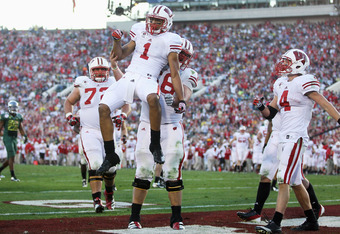 PASADENA, CA - JANUARY 02:  Wide receiver Nick Toon #1 of the Wisconsin Badgers celebrates with teammates after catching an 18-yard touchdown in the third quarter at the 98th Rose Bowl Game on January 2, 2012 in Pasadena, California.  (Photo by Jeff Gross
