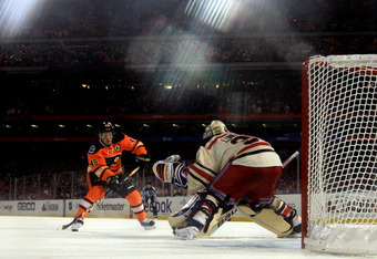 PHILADELPHIA, PA - JANUARY 02:  Henrik Lundqvist #30 of the New York Rangers makes a save on a penalty shot by Danny Briere #48 of the Philadelphia Flyers late in the third period during the 2012 Bridgestone NHL Winter Classic at Citizens Bank Park on Jan