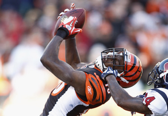 CINCINNATI, OH - DECEMBER 11:  A.J. Green #18 of the Cincinnati Bengals makes a catch in front of Jonathan Joseph #24 of the Houston Texans during their game at Paul Brown Stadium on December 11, 2011 in Cincinnati, Ohio. The Texans defeated the Bengals 2