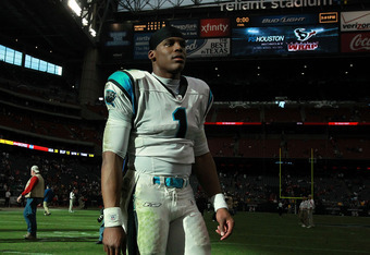 HOUSTON, TX - DECEMBER 18:  Cam Newton #1 of the Carolina Panthers walks off the field after a win against the Houston Texans at Reliant Stadium on December 18, 2011 in Houston, Texas.  (Photo by Ronald Martinez/Getty Images)