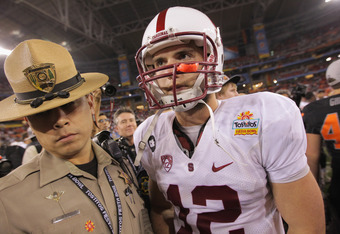 GLENDALE, AZ - JANUARY 02:  Andrew Luck #12 of the Stanford Cardinal walks off of the field after Stanford lost 41-38 in overtime against the Oklahoma State Cowboys during the Tostitos Fiesta Bowl on January 2, 2012 at University of Phoenix Stadium in Gle