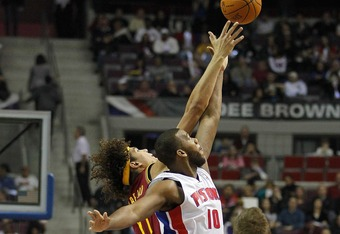 AUBURN HILLS, MI - DECEMBER 28: Greg Monroe #10 of the Detroit Pistons takes the opening tip off against Anderson Varejao #17 of the Cleveland Cavaliers on December 28, 2011 at the Palace of Auburn Hills in Auburn Hills, Michigan. Cleveland won the game 1