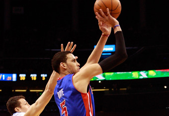 ORLANDO, FL - JANUARY 24: Hedo Turkoglu #15 of the Orlando Magic attempts to block the shot of Austin Daye #5 of the Detroit Pistons during the game at Amway Arena on January 24, 2011 in Orlando, Florida.  NOTE TO USER: User expressly acknowledges and agr