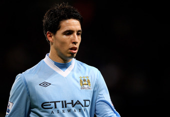 MANCHESTER, ENGLAND - DECEMBER 21:   Samir Nasri of Manchester City looks on during the Barclays Premier League match between Manchester City and Stoke City at the Etihad Stadium on December 21, 2011 in Manchester, England.  (Photo by Alex Livesey/Getty I
