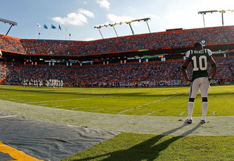 MIAMI GARDENS, FL - JANUARY 01:   Santonio Holmes #10 of the New York Jets looks on during a game against the Miami Dolphins at Sun Life Stadium on January 1, 2012 in Miami Gardens, Florida.  (Photo by Mike Ehrmann/Getty Images)