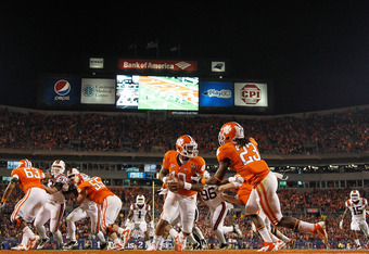 CHARLOTTE, NC - DECEMBER 03:  Tajh Boyd #10 of the Clemson Tigers hands off to Andre Ellington #23 during the ACC Championship game against the Virginia Tech Hokies at Bank of America Stadium on December 3, 2011 in Charlotte, North Carolina.  (Photo by Mi