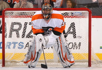 GLENDALE, AZ - DECEMBER 03:  Goaltender Ilya Bryzgalov #30 of the Philadelphia Flyers in action during the NHL game against the Phoenix Coyotes at Jobing.com Arena on December 3, 2011 in Glendale, Arizona.  The Flyers defeated the Coyotes 4-2.  (Photo by