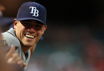 ARLINGTON, TX - SEPTEMBER 30:  Matt Moore #55 of the Tampa Bay Rays smiles in the dugout in the 9th inning against the Texas Rangers during Game One of the American League Division Series at Rangers Ballpark in Arlington on September 30, 2011 in Arlington