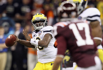 NEW ORLEANS, LA - JANUARY 03:  Denard Robinson #16 of the Michigan Wolverines throws a pass against the Virginia Tech Hokies during the Allstate Sugar Bowl at Mercedes-Benz Superdome on January 3, 2012 in New Orleans, Louisiana.  (Photo by Matthew Stockma