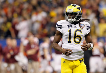 NEW ORLEANS, LA - JANUARY 03:  Denard Robinson #16 of the Michigan Wolverines looks on in the third quarter against the Virginia Tech Hokies during the Allstate Sugar Bowl at Mercedes-Benz Superdome on January 3, 2012 in New Orleans, Louisiana.  (Photo by