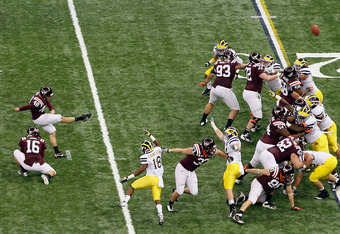 NEW ORLEANS, LA - JANUARY 03:  Kicker Justin Myer #48 of the Virginia Tech Hokies kicks a successful 37-yard field goal attempt in the first quarter against the Michigan Wolverines during the Allstate Sugar Bowl at Mercedes-Benz Superdome on January 3, 20
