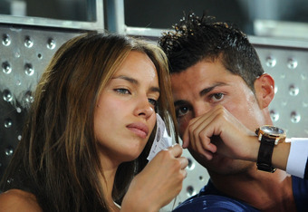 MADRID, SPAIN - AUGUST 22:  Irina Shayk (L) watches on besides Cristiano Ronaldo of Real Madrid while enjoying a friendly basketbal game between Spain and the USA at La Caja Magica on August 22, 2010 in Madrid, Spain.  (Photo by Jasper Juinen/Getty Images