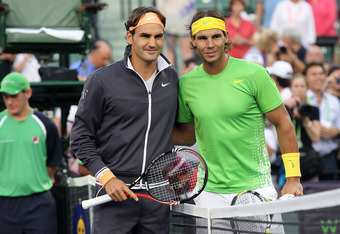 KEY BISCAYNE, FL - APRIL 01:  (L-R) Roger Federer of Switzerland and Rafael Nadal of Spain pose for a photo at the net prior to their men's semifinal match during the Sony Ericsson Open at Crandon Park Tennis Center on April 1, 2011 in Key Biscayne, Flori